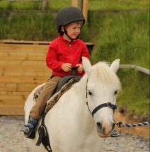 Pony rides Devon - A young child riding a pony