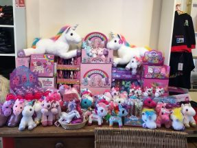 Gift shop treats - A collection of unicorn soft toys and gifts